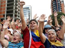 As crisis deepens, hope and defiance in Venezuela